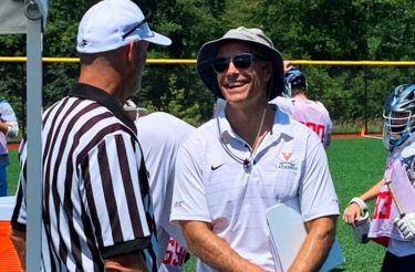 Lars Tiffany from Virgina talks with an official at the National High School Lacrosse Showcase. Photo by Derek Toney